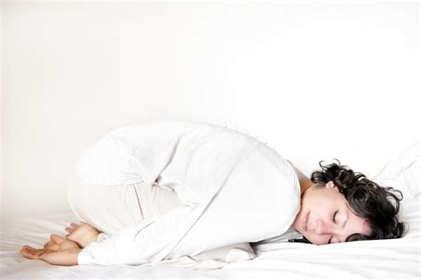 yoga in bed relaxing yoga poses and moves you can do in bed popsugar