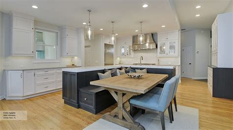 kitchen featuring an island with bench seating omega