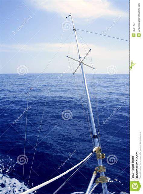 sea fishing boat equipment blue sea with outrigger fishing boat equipment royalty