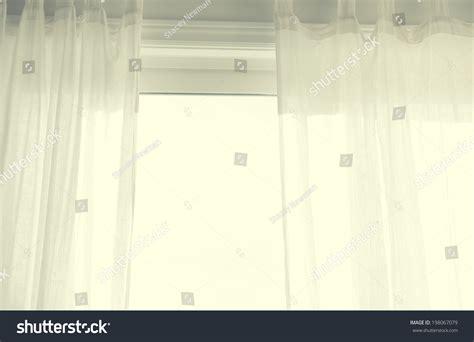 white see through curtains white see through curtains half open stock photo 198067079