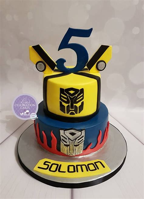 Two Tier Transformer Themed Cake With Handpainted Logos
