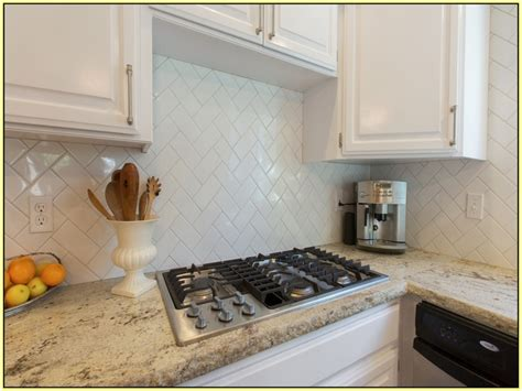 what size subway tile for kitchen backsplash beveled subway tile backsplash herringbone roselawnlutheran