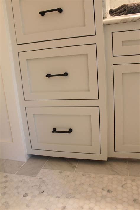 white and chrome cabinet knobs cabinet hardware the cabinet color is wickham gray by