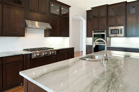 white kitchen cabinets and white countertops using white granite countertops for modern kitchen