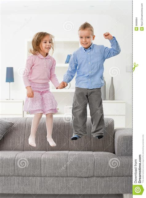 no jumping on the couch children jumping on couch stock images image 9688884