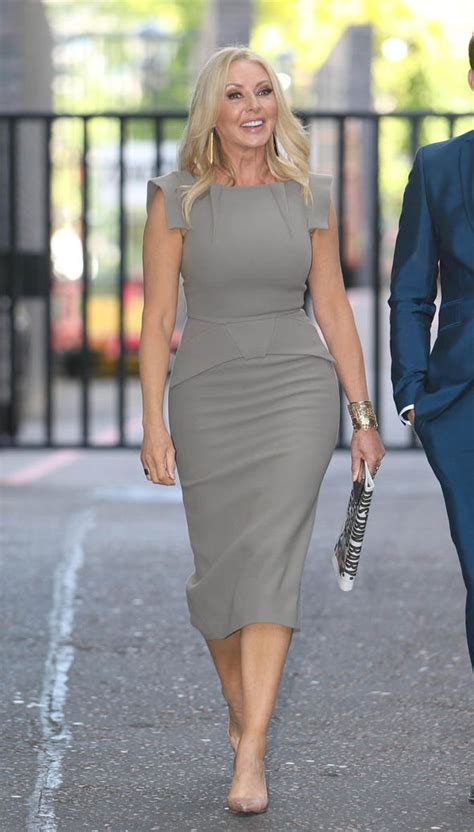 carol vorderman flaunts  amazing curves  skintight
