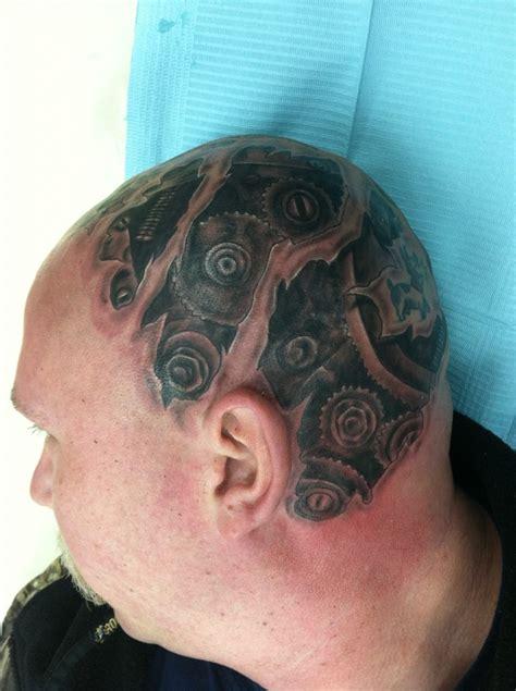 gearhead tattoos custom black and grey gear head skin rip tear head tattoo