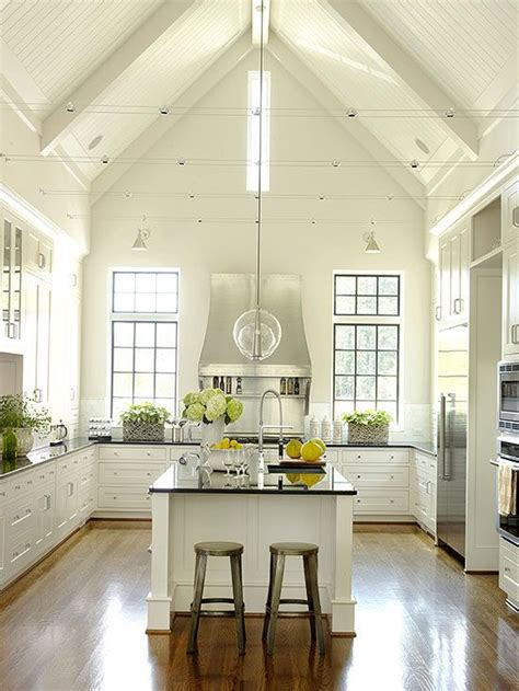 Lighting For Cathedral Ceiling In The Kitchen A Vaulted Ceiling And Bead Board Reinforce The Country Meets Cottage Meets Contemporary Feel Of