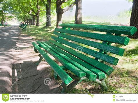 green park bench green bench in a park royalty free stock images image