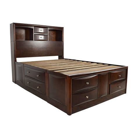 bed with drawers underneath and bookcase headboard