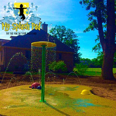 umbrella water play features splash pads water parks safety surfaces  splash pad