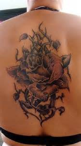 rose with thorns tattoo