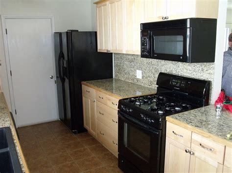 White Kitchen Cabinet Ideas With Black Appliances Nrtradiant.com