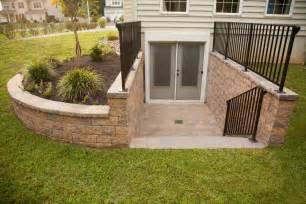 outside basement door covers custom egree from basement with landscape walls by