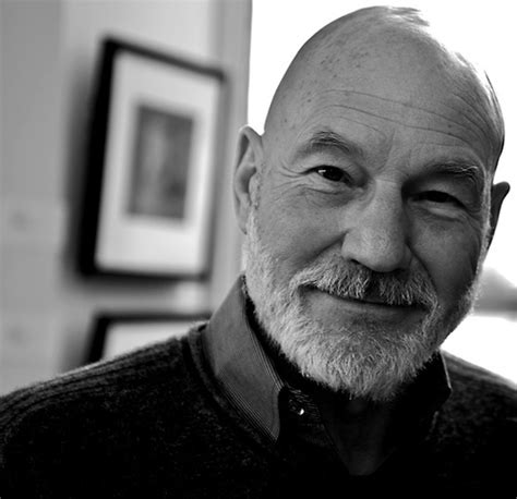 bald actor with white beard patrick stewart patrick stewart in an art gallery