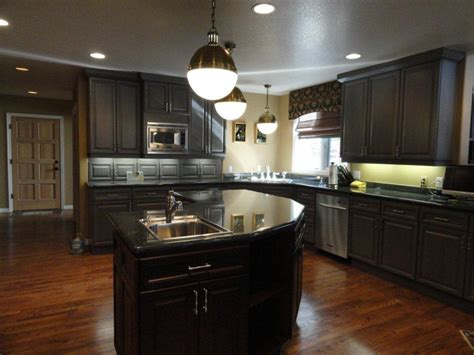 pictures of kitchens with black cabinets 25 traditional dark kitchen cabinets godfather style