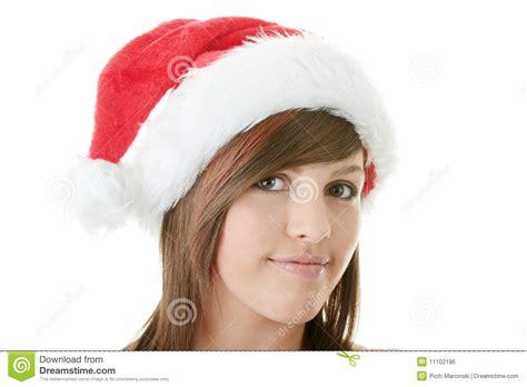 teen woman wearing santa hat stock photo image 11102196