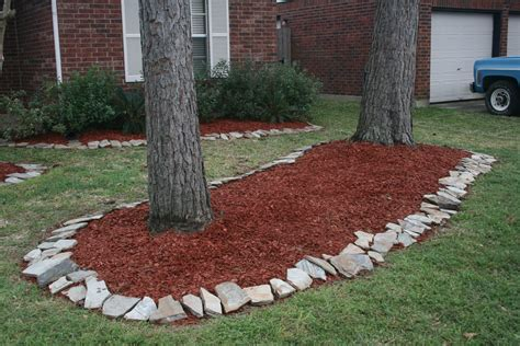 flower beds with rock borders home decorating ideas