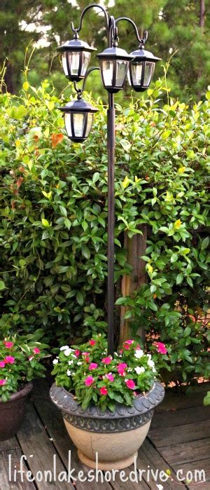 solar l post and planter diy solar light l post with flower planter on