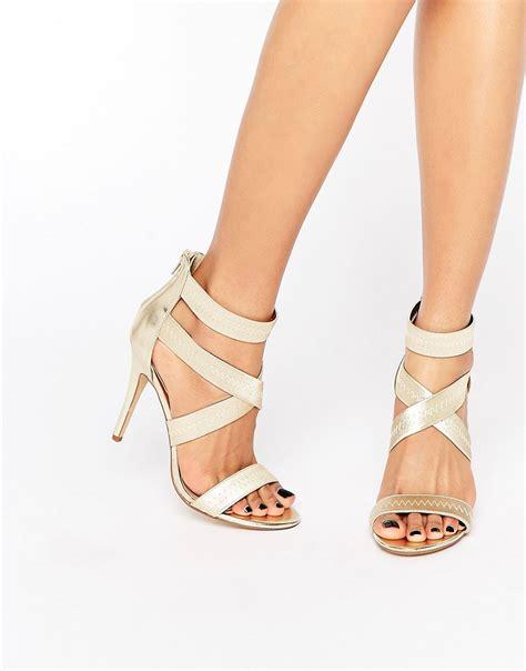 lyst steve madden paryss cross heeled sandals gold in metallic
