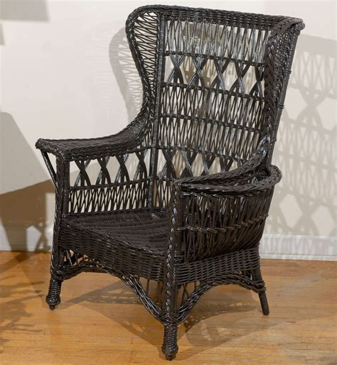antique wing chair antique american wicker wing chair with magazine pocket at 1stdibs