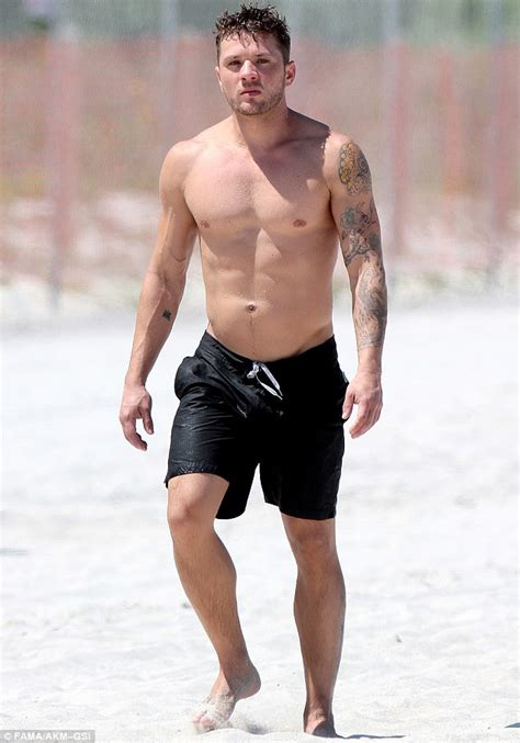 ryan phillippe shows off his toned body with clad