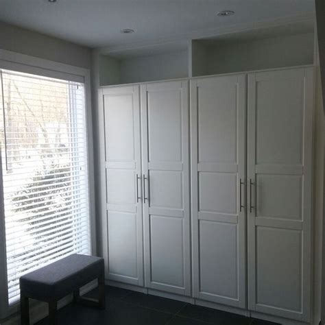ikea pax wardrobes cleverly built   top shelves