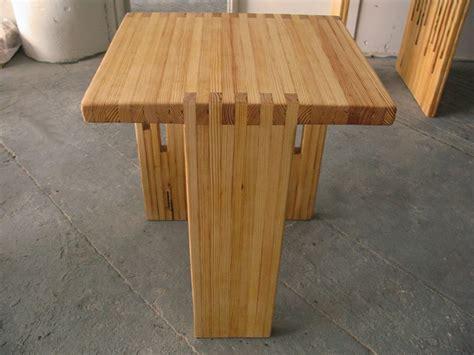 lilly split dining table  spliced  rudder leg   accent   grain