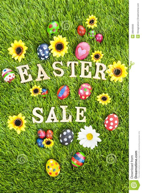 easter sale eggs on grass vertical stock photos image
