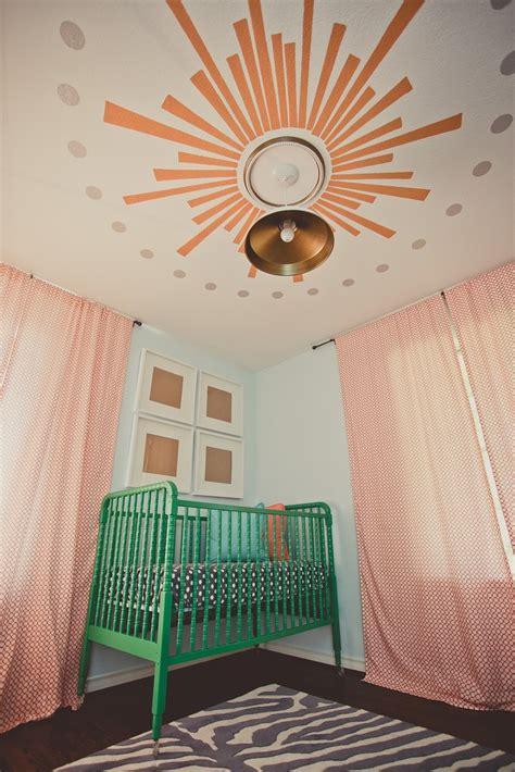 stunning nursery with custom painted lind crib in