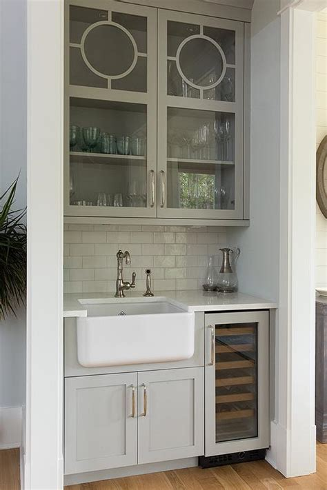 gray glass front wet bar cabinets over farmhouse sink