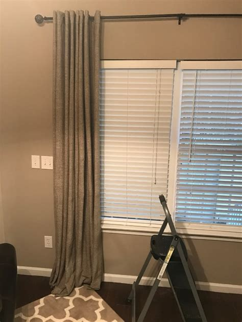 hang curtains high how high to hang curtains