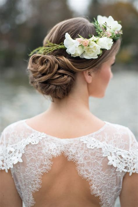 Bridal Hairstyles With Flowers by Wedding Hairstyles Updos With Flowers