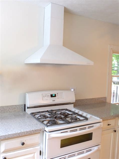 small white kitchen with steel hood we painted our stainless steel range hood