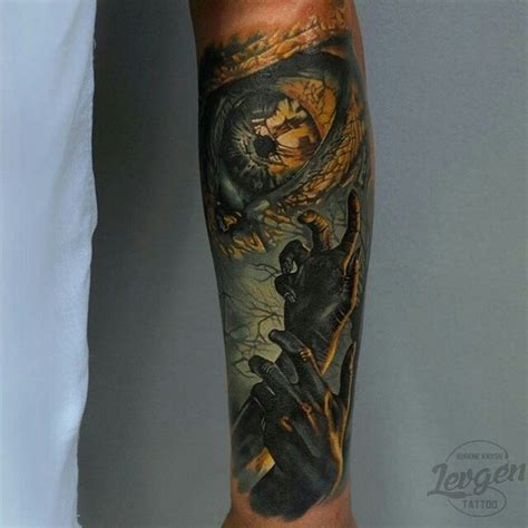 eye keyhole tattoo colored mystical looking forearm tattoo of creepy hands