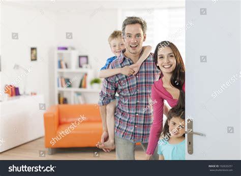 Family Door by Family Standing Front Door Invite Stock Photo