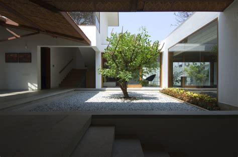 homes with interior courtyards 1 central tree and pebble courtyard interior design ideas
