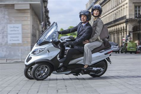 piaggio updates the mp3 500 adds abs asc scooterfile