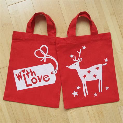 christmas reindeer gift bag by helen rawlinson
