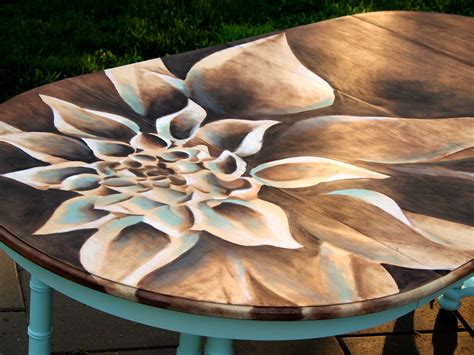 artistic woodworking dahlia stained artwork on dining table sawdust and embryos