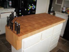 kitchen island with chopping block top custom built in knife block on butcher block work island