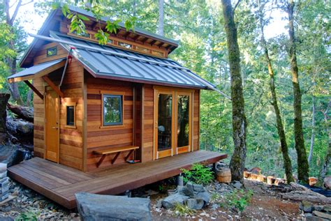 tiny house cabin serenity now tiny house in the forest on a hill small