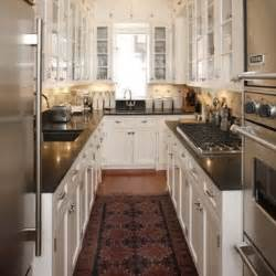 This u shaped galley kitchen takes full advantage of its ceiling