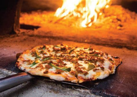 Wood Handcrafted Pizza - harpo s pizza launches handmade wood fired pizzas at the