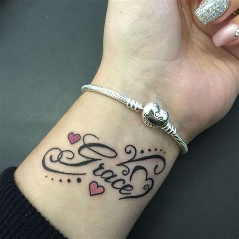 name tattoos on wrist for men name wrist tattoos designs ideas and meaning tattoos