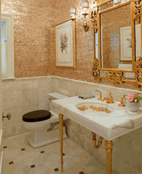 gold bathroom tile to da loos gold faucets giving your bathroom the midas