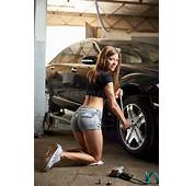 Girl With Body Repairs The Front Wheel Of Car Stock Image