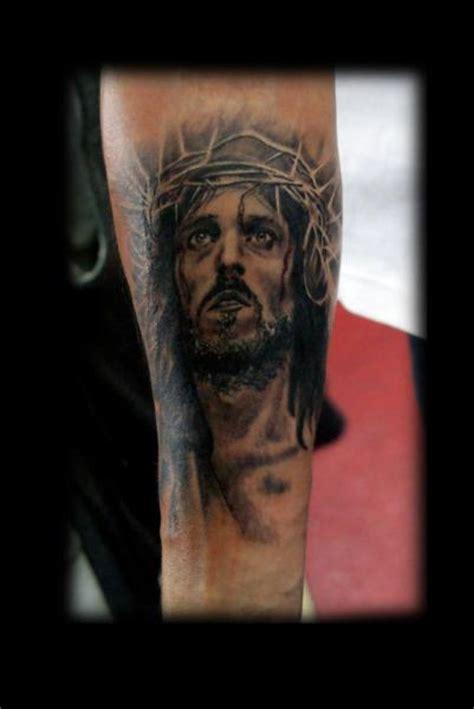 jesus tattoo underarm arm jesus religious tattoo by alans tattoo studio