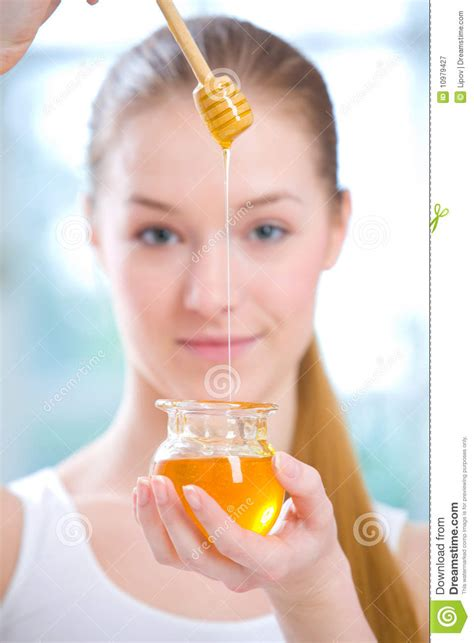 young girl honey pot girl with jar of honey royalty free stock photography