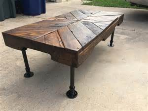 Rustic pallet coffee table with pipe legs pallet